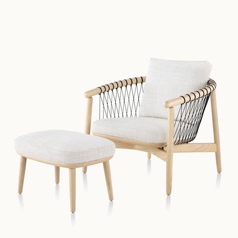 Angled view of a Crosshatch lounge chair and ottoman with off-white fabric. Select to go to the Crosshatch Chair and Ottoman product page.