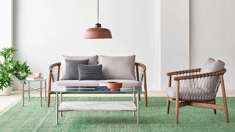 A casual lounge setting featuring a Crosshatch Settee, Crosshatch Chair, and Layer Tables.