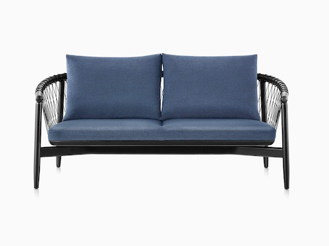 A dark colored Crosshatch Settee featuring navy upholstery and an ebony on ash frame.