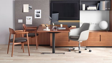 An executive office featuring Geiger Rhythm Casegoods, a light gray Saiba office chair, and two Crosshatch Side Chairs with black leather seat pads.