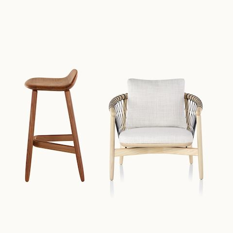 Side view of a wood Crosshatch Stool with a medium finish next to a front view of a Crosshatch lounge chair with off-white fabric.