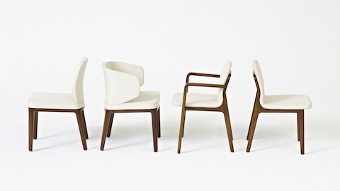 Side view of four Geiger side chairs, including an armless A Line, a wingback A Line, a Deft with arms, and an armless Deft.