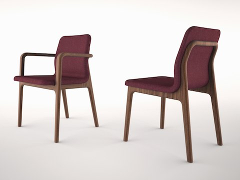 Angled view of two Deft side chairs with burgundy fabric, one with arms and one without.