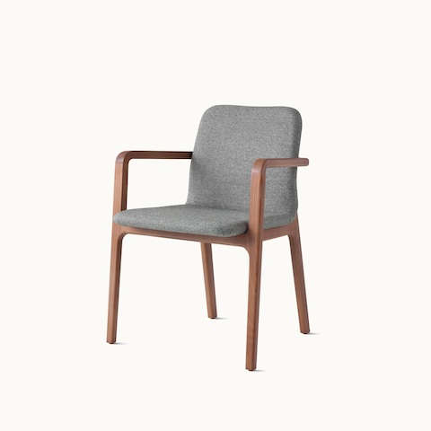Angled view of a Deft side chair with arms, ivory-colored fabric, and a wood frame in a medium finish. Select to go to the Deft Chair product page.