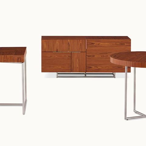 A Domino Table, Domino Desk, and Domino Storage credenza, all with matching wood veneer and metal finishes.