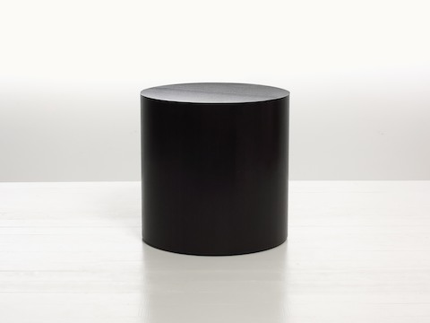 A round Drum occasional table with a dark veneer-clad base and a metal inlay finish, viewed from the front.