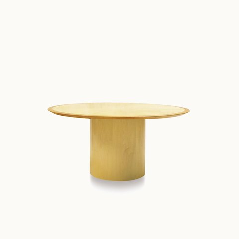 A round Drum conference table with a light veneer-clad base.