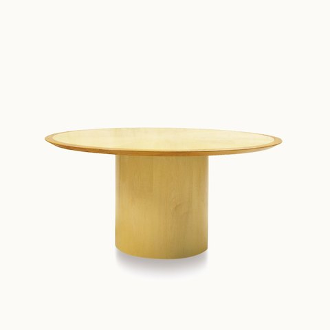 A round Drum conference table with a light veneer-clad base. Select to go to the Drum Tables product page.