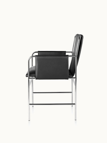 Side view of an Envelope side chair with black leather upholstery and a tubular steel frame.