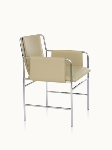 Angled view of an Envelope side chair with beige leather upholstery and a tubular steel frame.