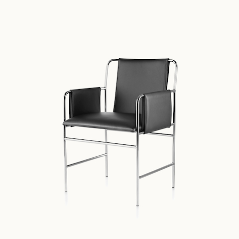 Angled view of an Envelope side chair with black leather upholstery and a tubular steel frame. Select to go to the Envelope Chair product page.