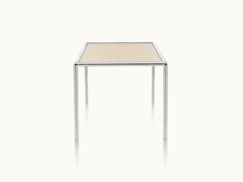 A rectangular Full Round coffee table with a light wood top and tubular metal frame, viewed from the side.