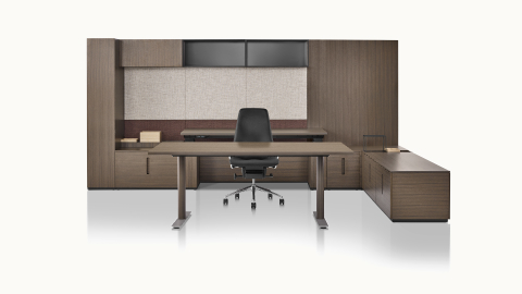 A private office featuring Geiger Rhythm Casegoods with a rectangular desk, height-adjustable work surface, and black leather Taper executive chair.