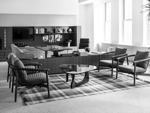 Black-and-white image of a private office featuring Geiger Rhythm Casegoods and a sitting area with four Crosshatch Chairs.