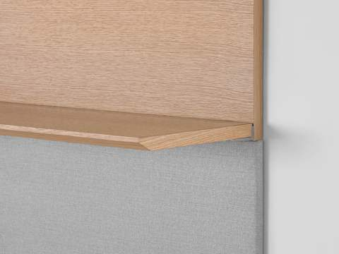 Close-up of the edge of a Geiger Shelf System shelf in a light rift oak finish, showing the premium wood veneer.
