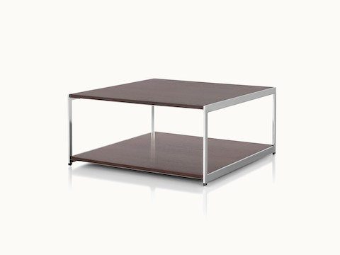 Angled view of an H Frame coffee table with a metal frame and wood surfaces in a dark finish.