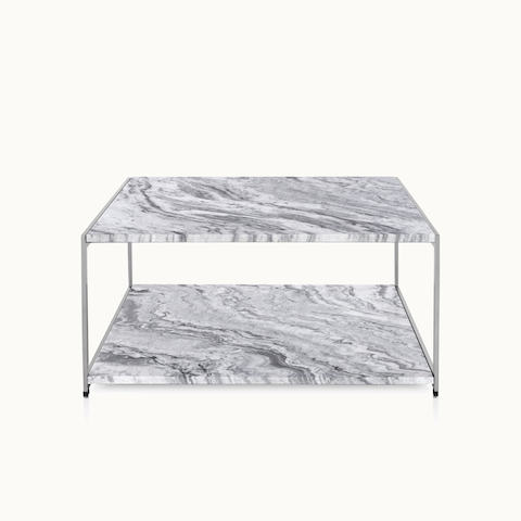 An H Frame coffee table with a metal frame and stone upper and lower surfaces.