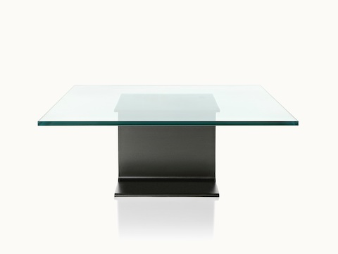 A glass-top I Beam coffee table, oriented to display the cast-aluminum pedestal's central section.
