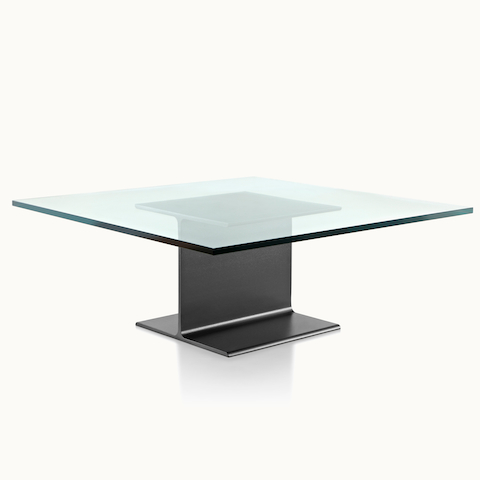 Angled view of a square I Beam coffee table with a glass top and black cast-aluminum pedestal.