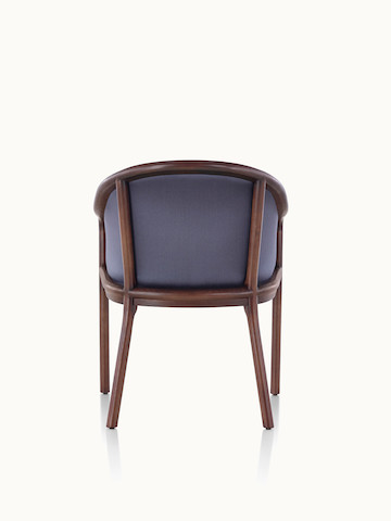 A Landmark side chair with dark blue French upholstery and a dark wood frame, viewed from behind.