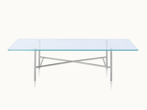A rectangular Layer coffee table with a glass top and cylindrical metal cross braces, viewed from the front.