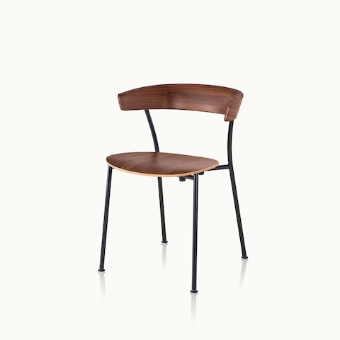 Angled view of a Leeway side chair with a metal frame and a wood backrest and seat in a medium finish. Select to go to the Leeway Chair product page.