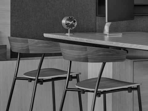 Black-and-white image of two Leeway side chairs used as guest seating in an executive office.