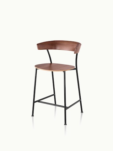 Angled view of a counter-height Leeway Stool with a metal frame and a wood backrest and seat in a medium finish.