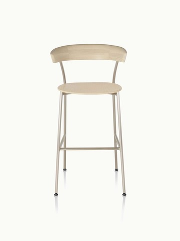 A bar-height Leeway Stool with a metal frame and a wood backrest and seat in a light finish, viewed from the front.