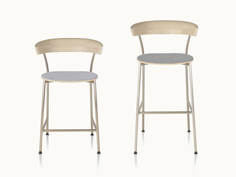 A counter-height Leeway Stool next to a bar-height Leeway Stool, both viewed from the front.