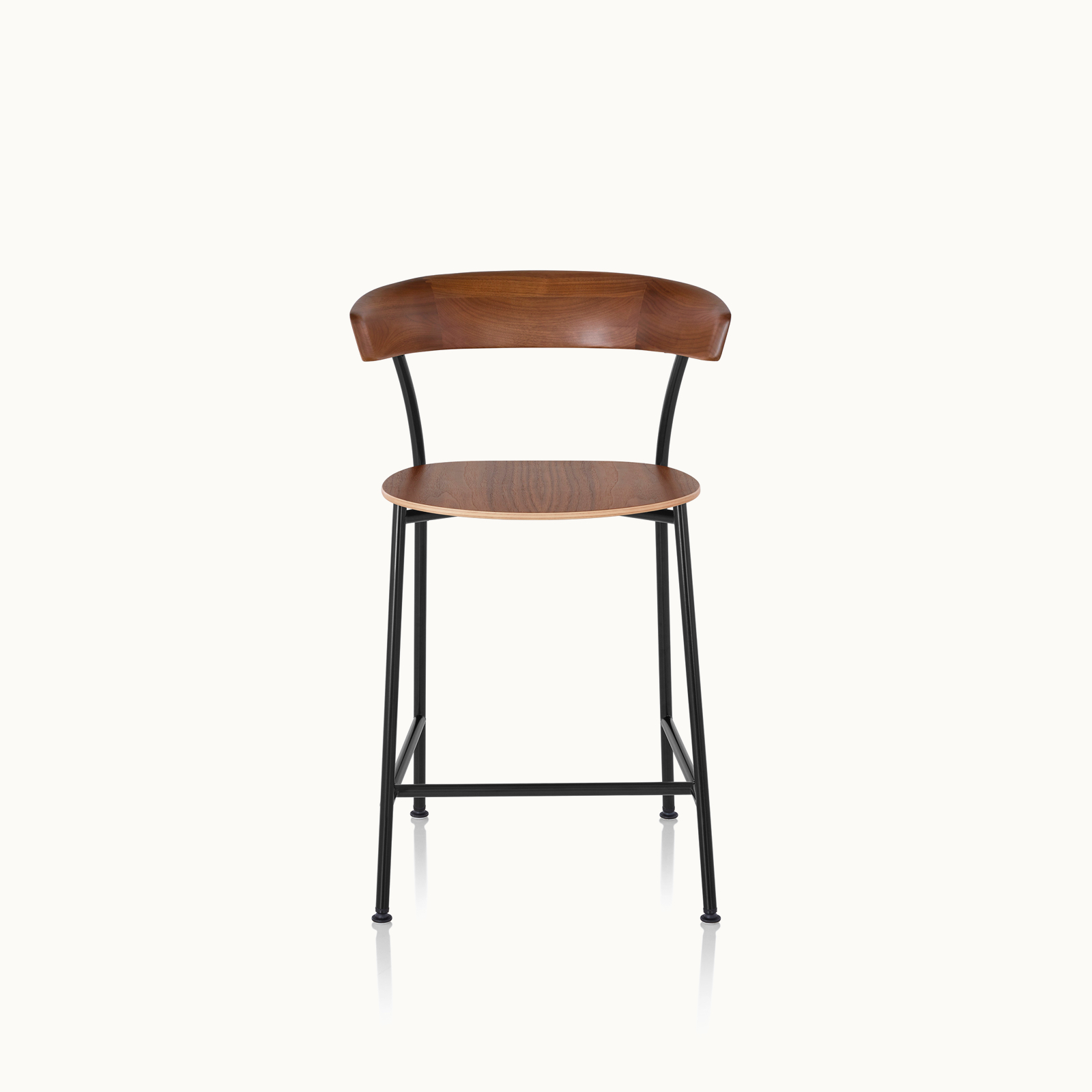 A Leeway Stool with a black metal frame and a wood backrest and seat in a medium finish, viewed from the front.