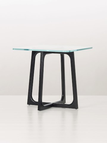 A square Loophole side table with a glass top and black wood base, viewed at an angle.