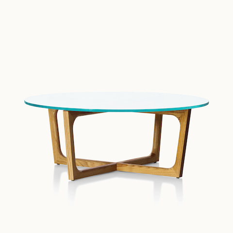 A round Loophole coffee table with a glass top and a wood base in a medium finish.