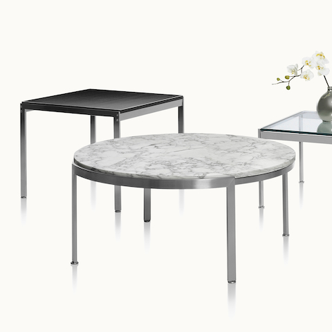 Three occasional tables with different top materials and shapes. Select to go to the Metal Series Tables product page.