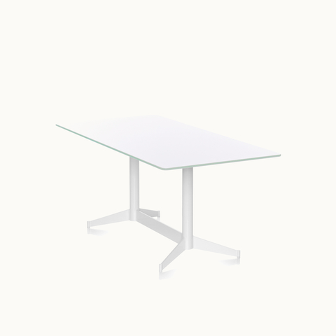 Angled view of a rectangular MP Table with a white back-painted glass top and white base. Select to go to the MP Tables product page.