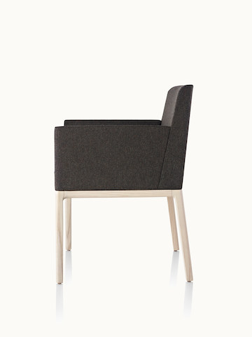 Side view of a Nessel side chair with black fabric upholstery, wraparound arms, and a wood frame with a light finish.