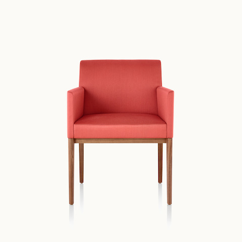A Nessel side chair with wraparound arms, red upholstery, and a wood frame with a medium finish, viewed from the front.