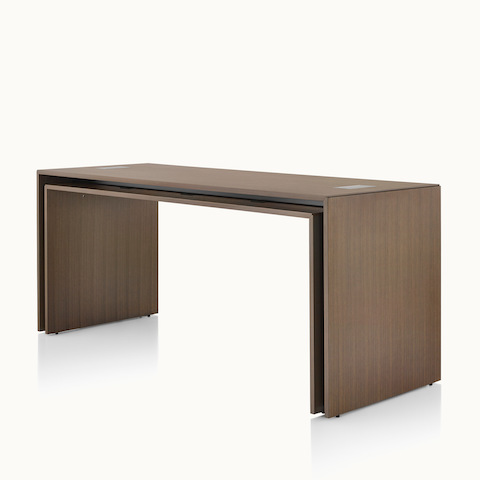 Angled view of a rectangular Peer Table in a dark wood finish. Select to go to the Peer Tables product page.
