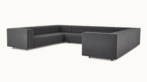A three-seat Rapport Sofa in a deep navy colored textile.