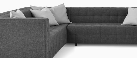 A Rapport sofa in a u-shaped configuration with throw pillows.