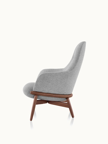 Side view of a high-back Reframe lounge chair with light gray upholstery and a wood frame in a medium finish.