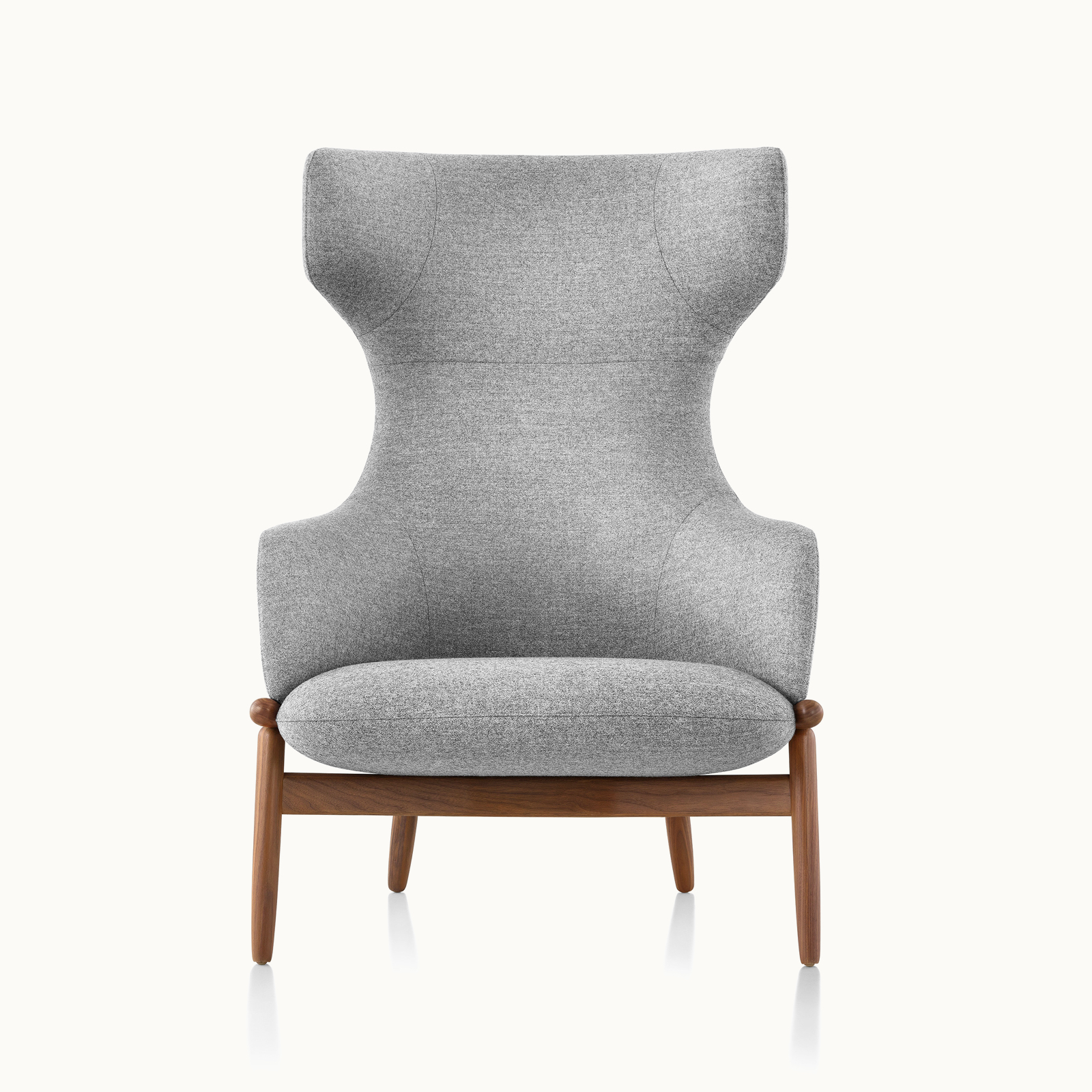 A wing-back Reframe lounge chair with light gray upholstery and a wood frame in a medium finish, viewed from the front.