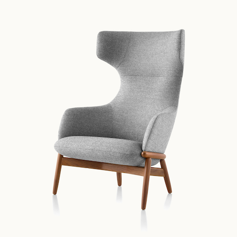Angled view of a wing-back Reframe lounge chair with light gray upholstery. Select to go to the Reframe Lounge Seating product page.