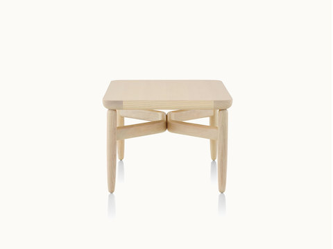 A square Reframe occasional table with a light wood finish.