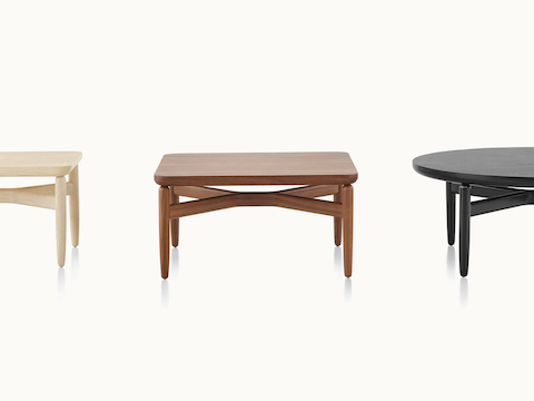 Three Reframe occasional tables with light, medium, and black finishes.