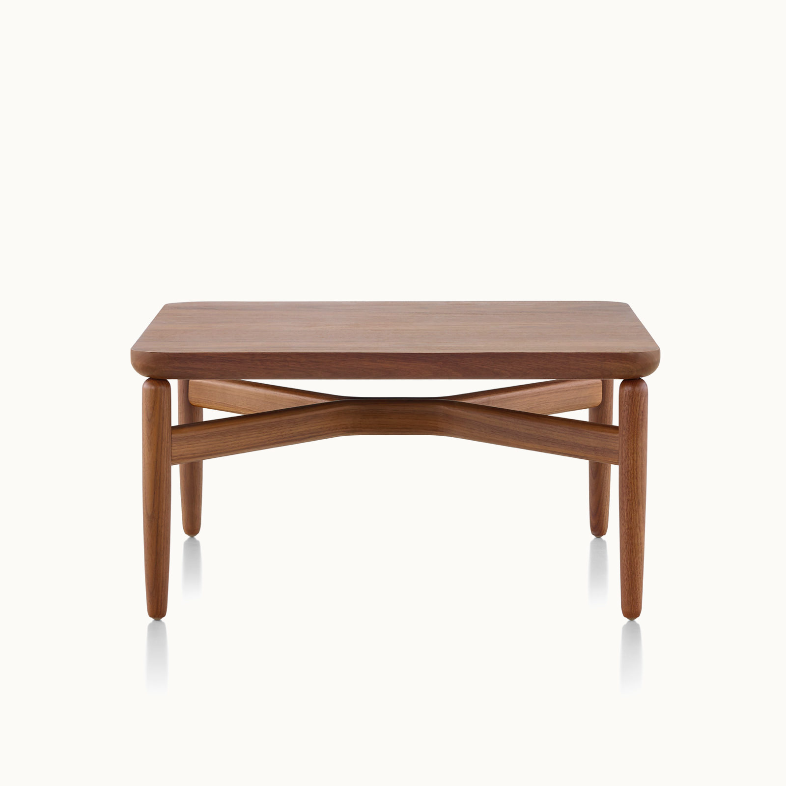 A rectangular Reframe occasional table with a medium wood finish, viewed from the front.