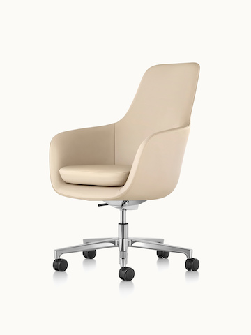 Angled view of a high-back Saiba office chair with beige leather upholstery and a five-star base.