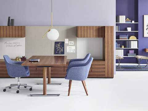 An executive office featuring Geiger Rhythm Casegoods, a light blue Saiba office chair, and two light blue Saiba Side Chairs.