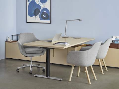 A private office featuring Geiger Rhythm Casegoods, a light gray Saiba office chair, and two light gray Saiba Side Chairs.