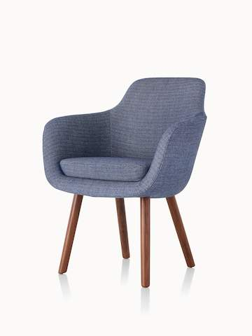 Angled view of a Saiba Side Chair with blue upholstery and wood legs in a medium finish.